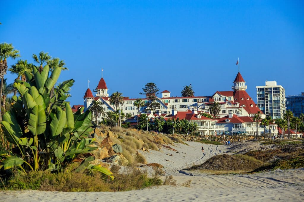 In the distance, on a clear day, the red and white Hotel Del stands strong against the San Diego backdrop