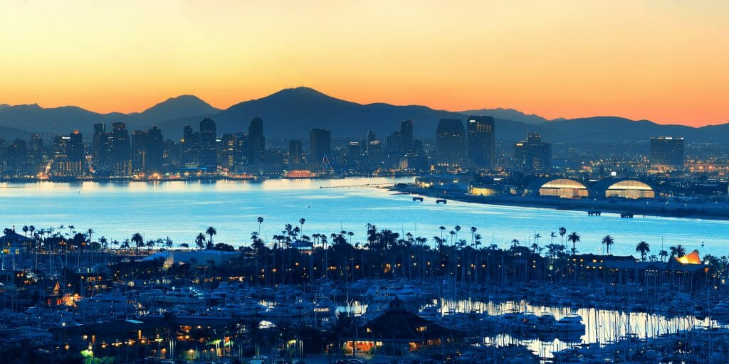 As the sunsets on San Diego, the glow of the water provides a mystic light for sailors and pedestrians around