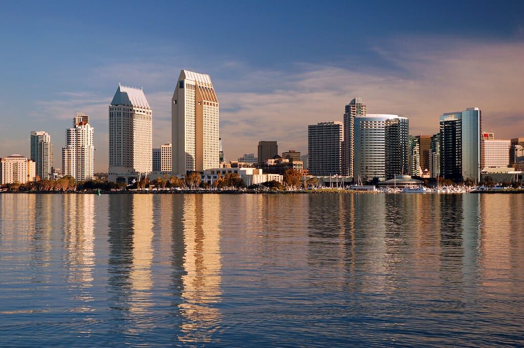 The San Diego skyline, as seen from Coronado Island, is reflected in the bay