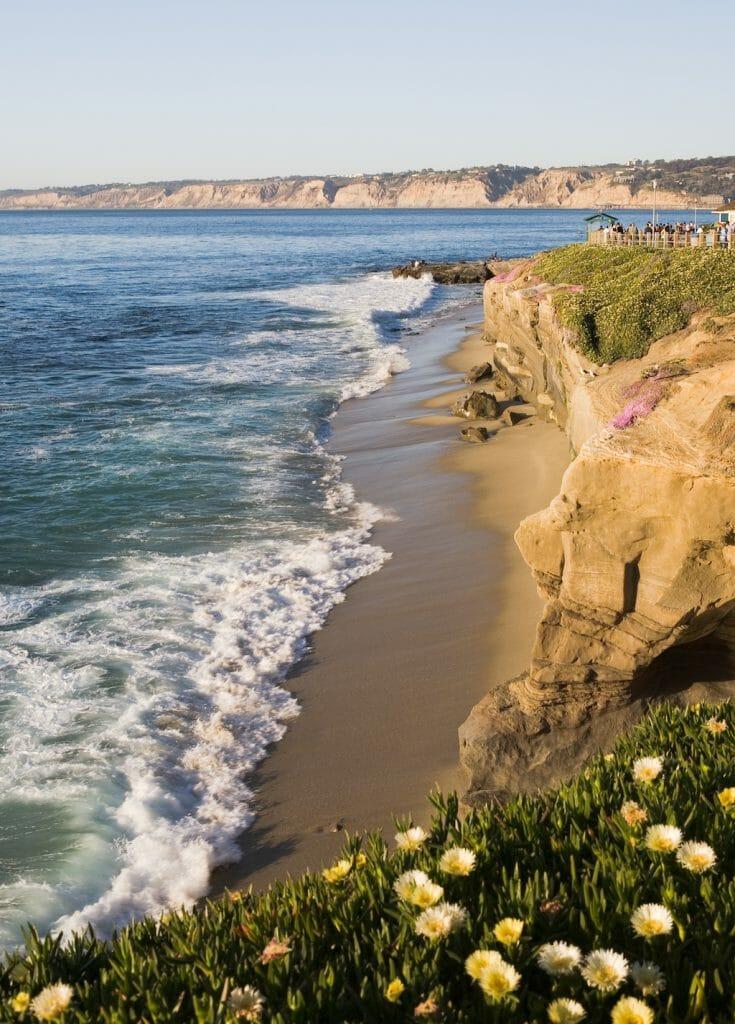 Beautiful cliffs, rocks, beach, and Pacific Ocean in La Jolla California in the late evening