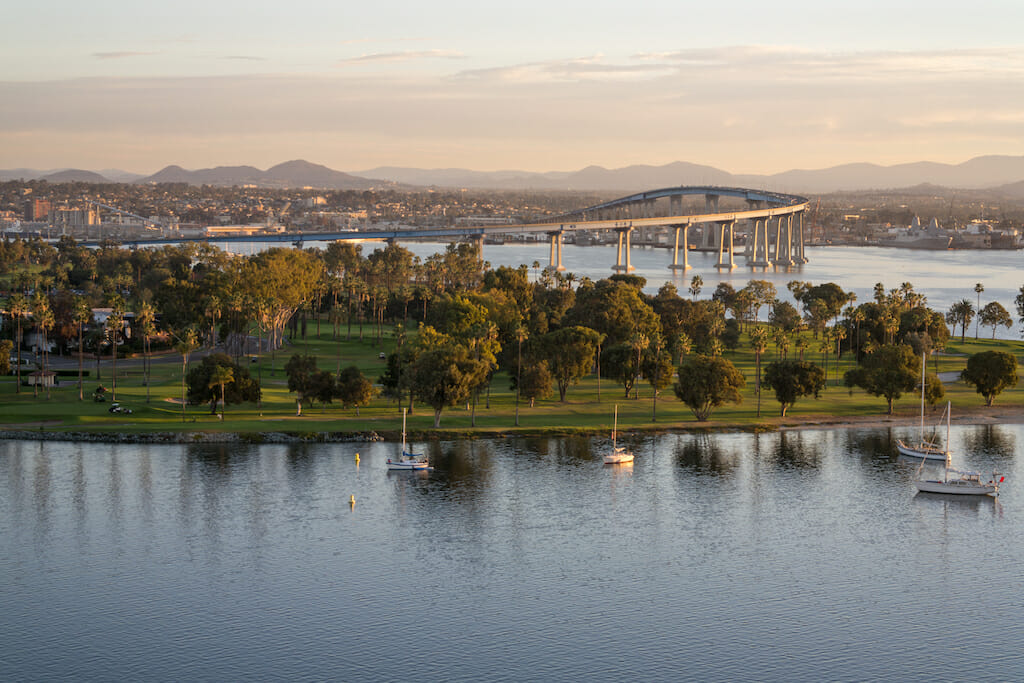 Dawn arrives at Coronado Island revealing the bay, golf course, village and coronado bridge.