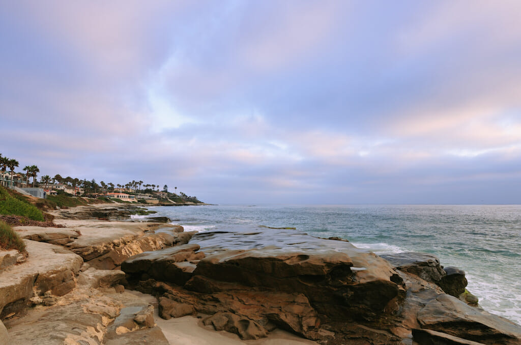 Colorful sky swirling above the ocean and La Jolla shores