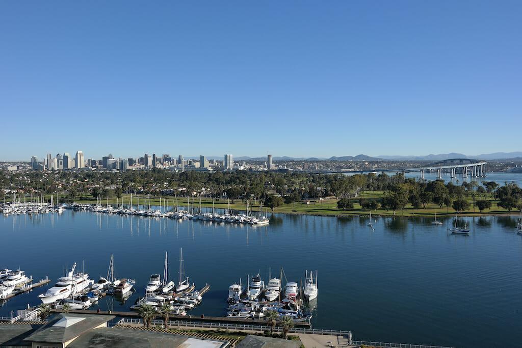 A panoramic view of Coronado bay marina, golf course and Coronado bay bridge with the backdrop of San Diego Downtown in California.