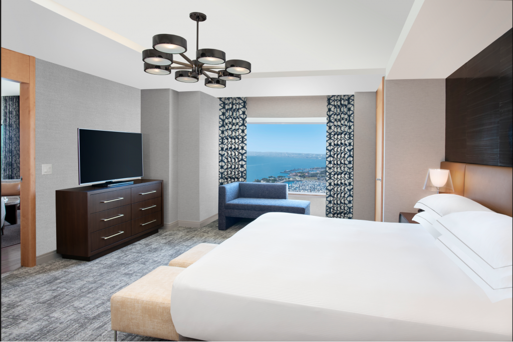 A brightly light and clean room with an ocean view