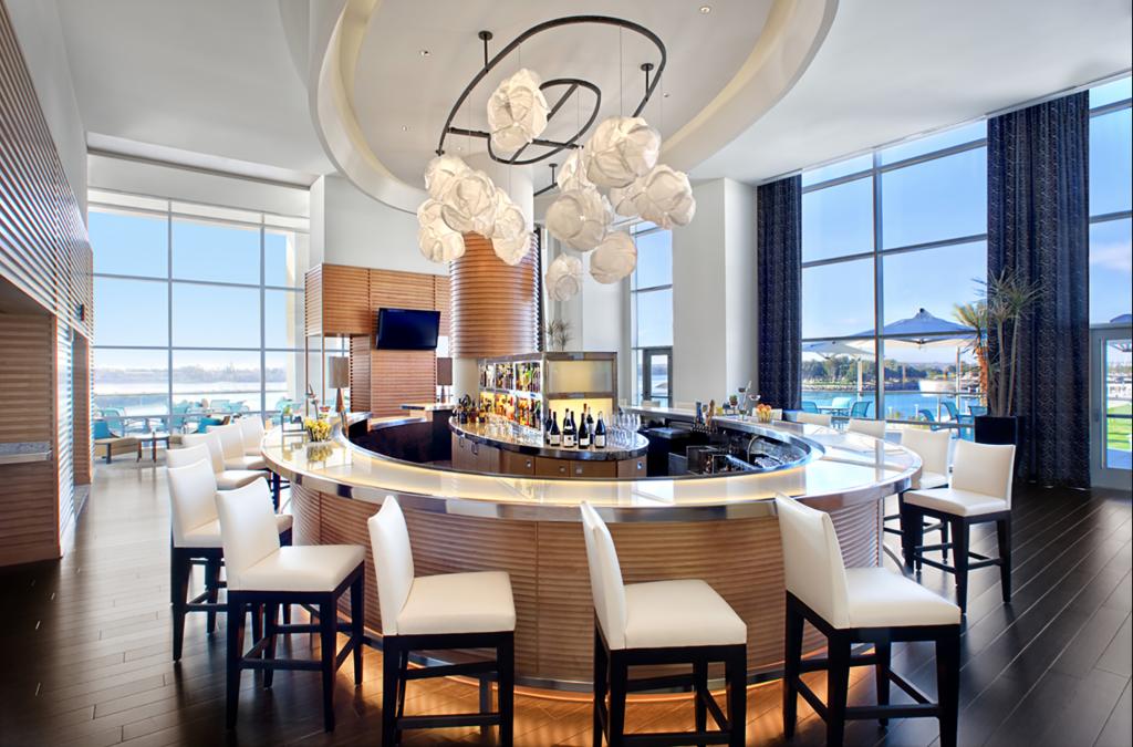 A brightly lit bar with modern chic decor