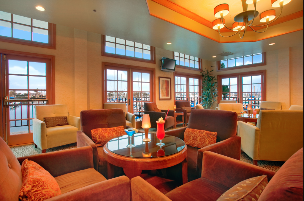 A orange tinted lobby with elegant decor and natural light