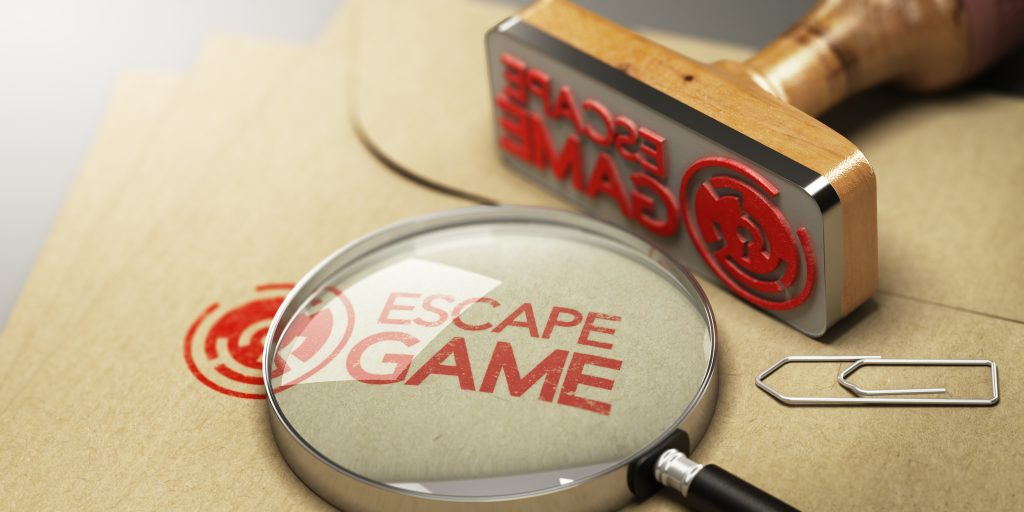 "stamp with red inc reading:""Escape Game"" and spy glass on manila envelope - Escape Room San Diego Valentines Day"