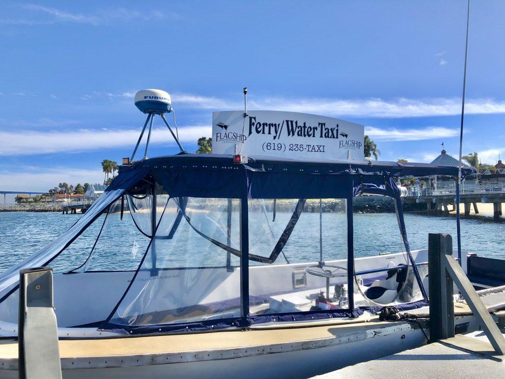 Small white boat on pier - San Diego Water Taxi Coronado Ferry