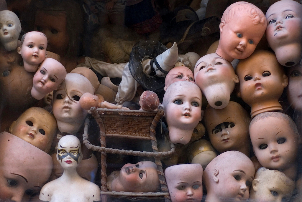 macabre display of old dolls heads