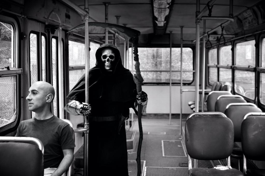 horror angel of death following man on bus