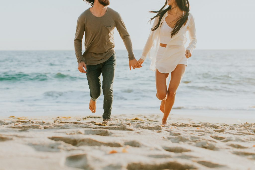 Couple running at the beach - Romantic Staycation in San Diego